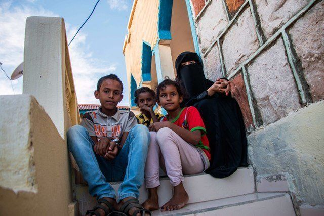 Thirteen-year-old Salim (far left) sits with his siblings in their temporary accommodation in Hargeisa, capital of Somaliland