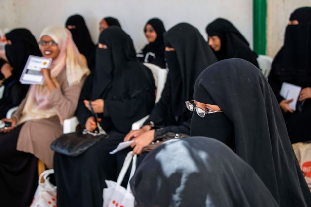 """Ashley Hamer The United Nations refugee agency (UNHCR) provides some assistance to refugees arriving in Somaliland from Yemen. Here, Yemeni women in Hargeisa wait to receive information and basic """"dignity kits,"""" which include sanitary products, clean underwear and basic toiletries."""