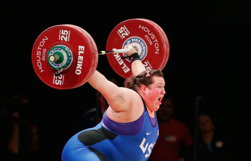 Sarah Robles of the United States competes in the women's +75kg weight class during the 2015 International Weightlifting Fede