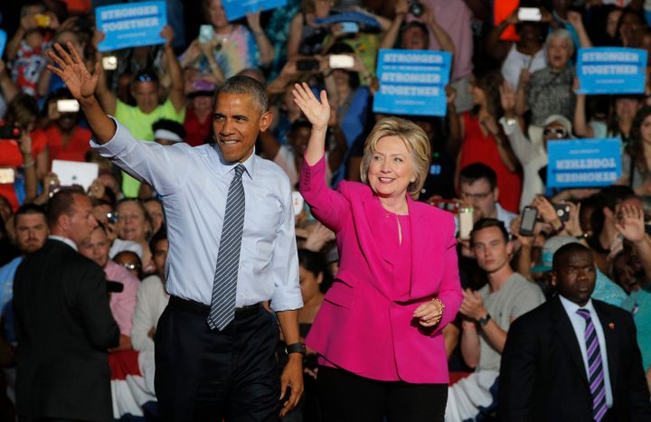 U.S. President Barack Obama waves with Democratic U.S. presidential candidate Hillary Clinton during a Clinton campaign event