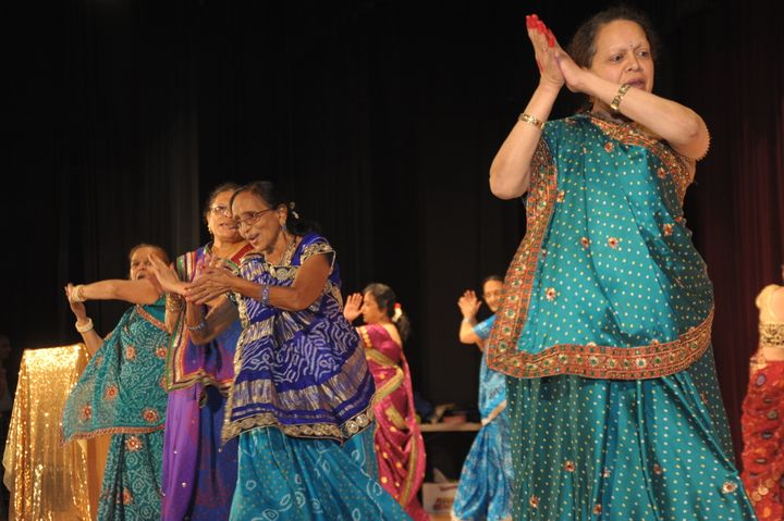 Seniors from India Home dance the garba, a vigorous folk dance from the state of Gujarat in western India.