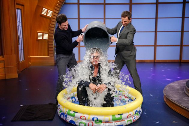 Seth Meyer dumps a bucket of ice on actor Mickey Rourke for the 'Ice Bucket
