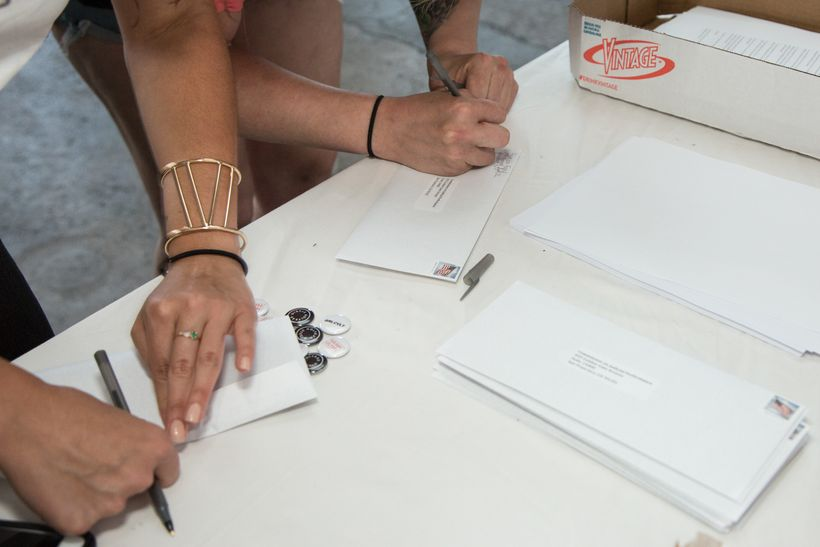 Women writing letters for the Recall Aaron Persky campaign.