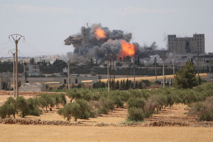 Smoke and flame rise after what fighters of the Syria Democratic Forces (SDF) said were U.S.-led air strikes on the mills of