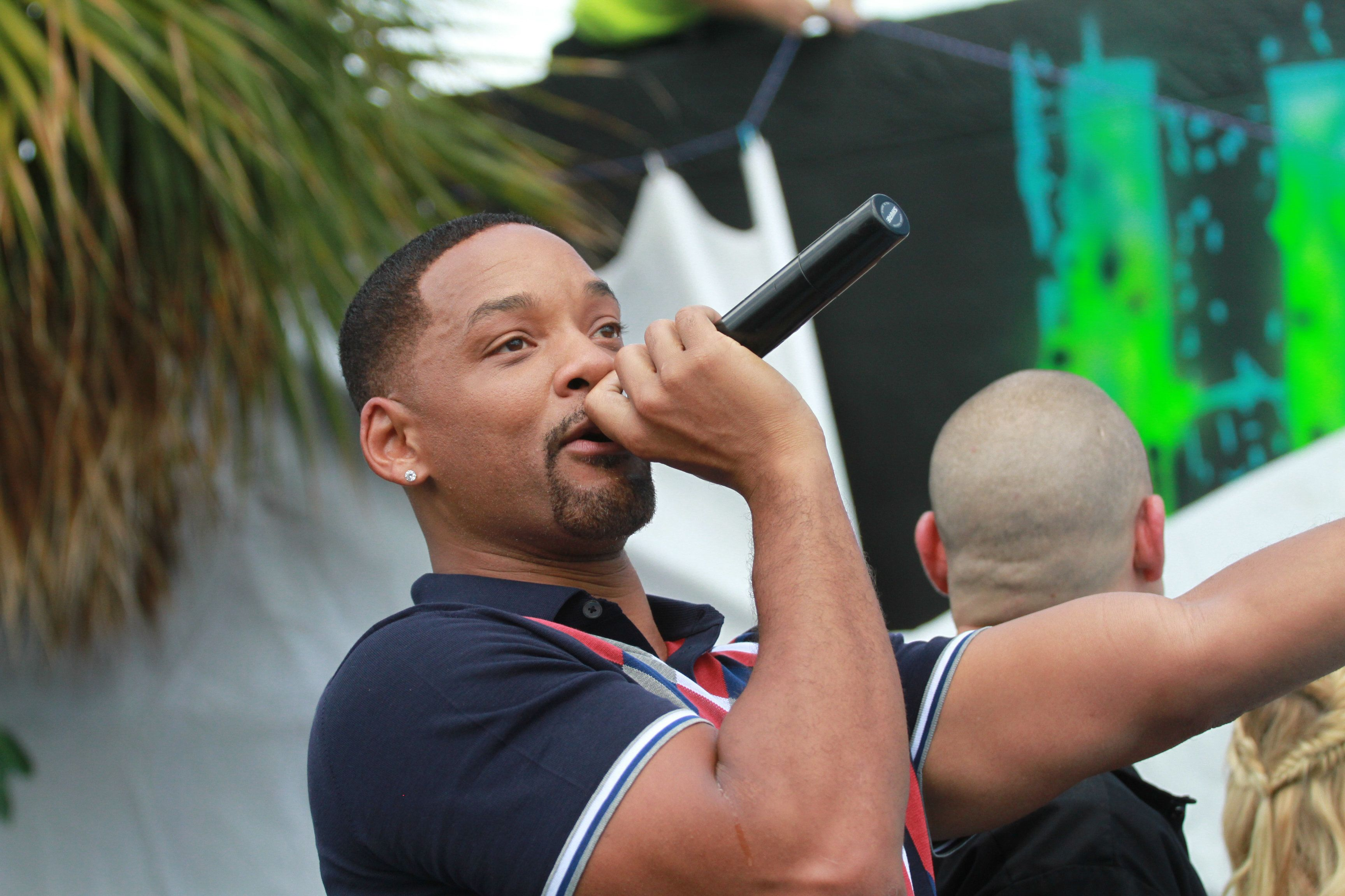 "Will Smith performs at the ""Suicide Squad"" Wynwood Block Party and mural reveal with the cast on July 25, 2016, in Miami"
