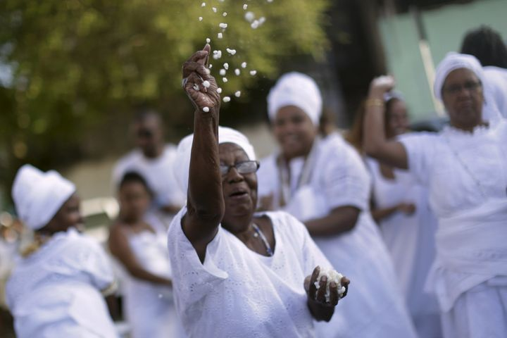 A Candomblé woman takes part in a protest against religious intolerance, along the streets of Salvador, Brazil Novembe
