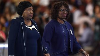 Felicia Sanders (R) and Polly Sheppard (L), two of the three survivors of the Mother Emanuel Church shooting in Charleston, SC, walk off the stage on the third evening session of the Democratic National Convention at the Wells Fargo Center in Philadelphia, Pennsylvania, July 27, 2016. / AFP / Nicholas Kamm        (Photo credit should read NICHOLAS KAMM/AFP/Getty Images)
