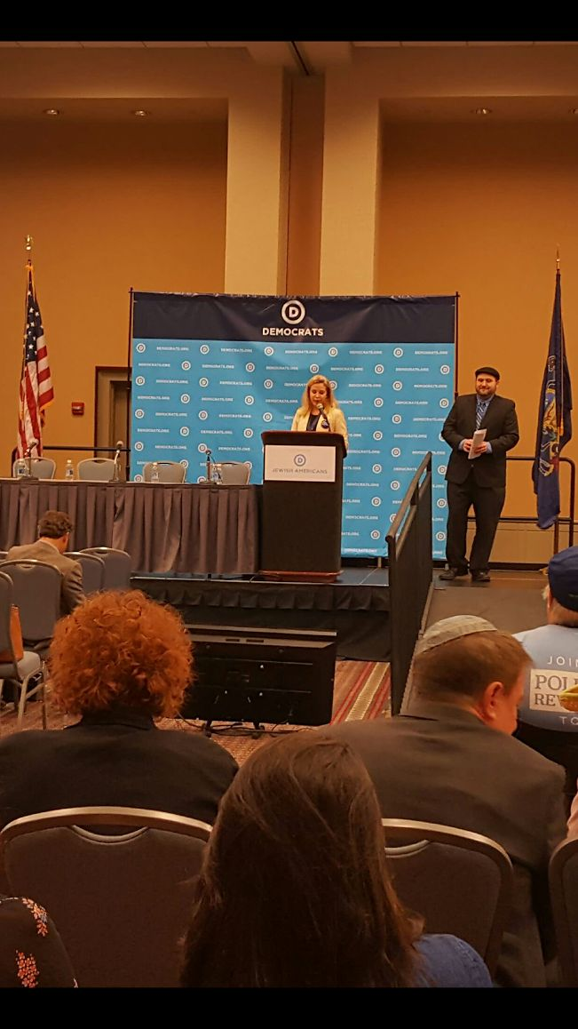 Sarah Bard addresses the Jewish Roundtable (DNC Director of Jewish Engagement Aaron Weinberg looks on)