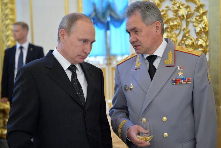 Russian President Vladimir Putin, left, with Defence Minister Sergei Shoigu, who says Moscow has deployed more air defen