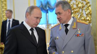 Russian President Vladimir Putin (L) talks to Defence Minister Sergei Shoigu during a reception to honour graduates of military academies at the Kremlin in Moscow, Russia, June 28, 2016. Sputnik/Kremlin/Alexei Druzhinin/via REUTERS ATTENTION EDITORS - THIS IMAGE WAS PROVIDED BY A THIRD PARTY. EDITORIAL USE ONLY.