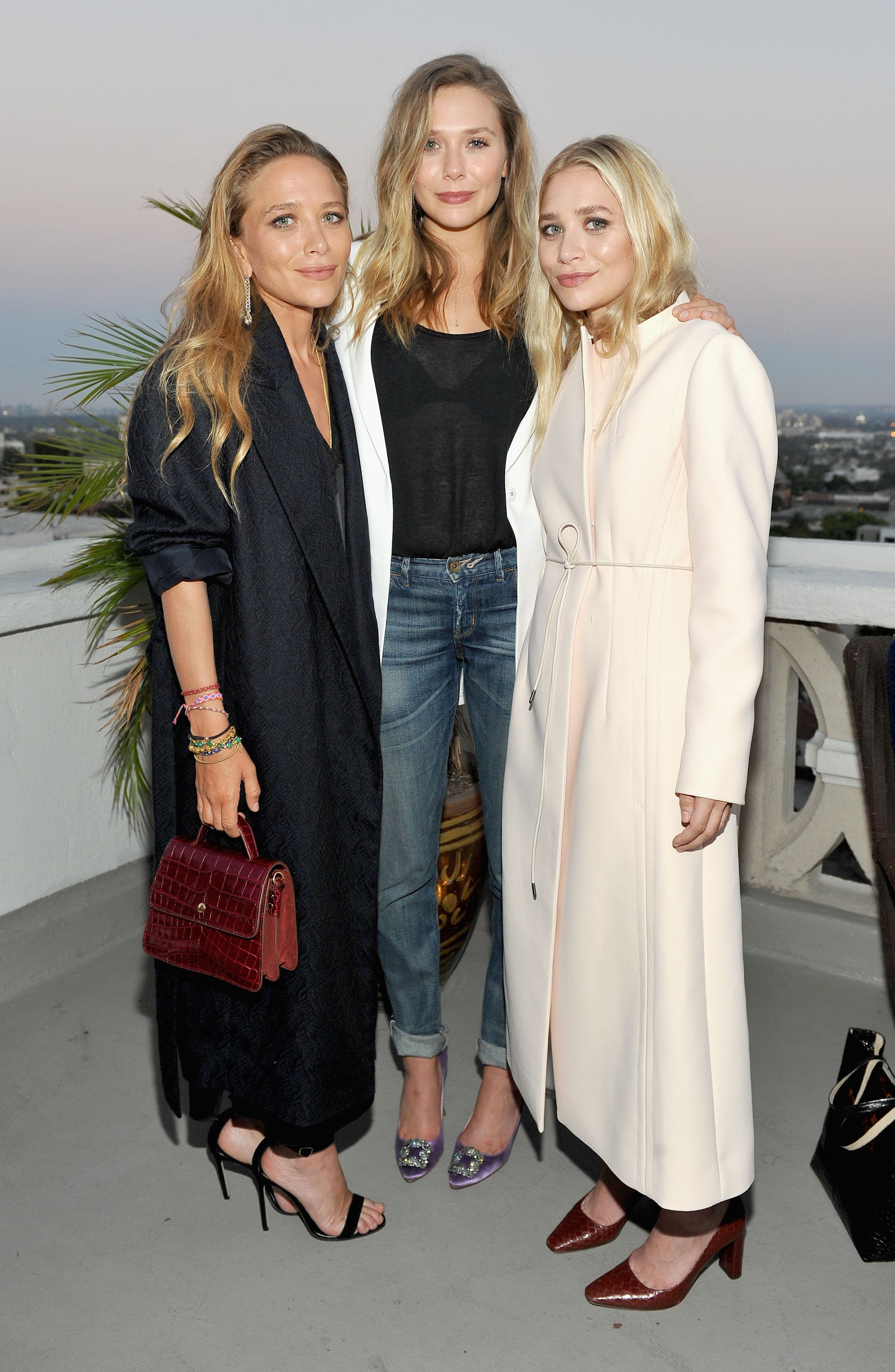 Mary-Kate, Elizabeth, and Ashley Olsen, dressed for a mix of seasons.