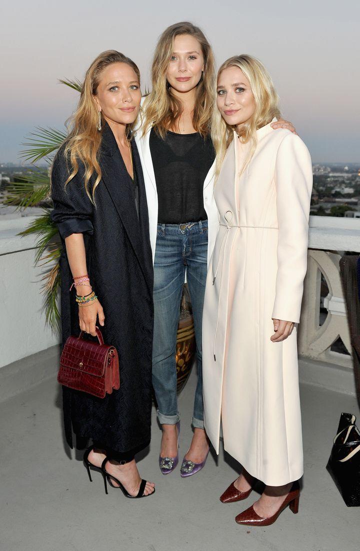 Mary-Kate, Elizabeth, and Ashley Olsen, dressed fora mix of seasons.
