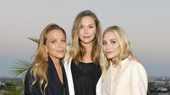 LOS ANGELES, CA - JULY 26:  (L-R) Designer Mary-Kate Olsen, actress Elizabeth Olsen and designer Ashley Olsen attend Elizabeth and James Flagship Store Opening Celebration with InStyle at Chateau Marmont on July 26, 2016 in Los Angeles, California.  (Photo by Donato Sardella/Getty Images for InStyle)