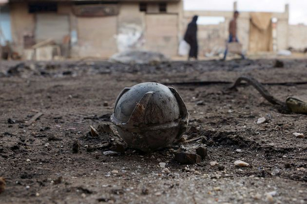 More than 100 countries have banned cluster munitions like this unexploded bomblet, pictured in Syria's...