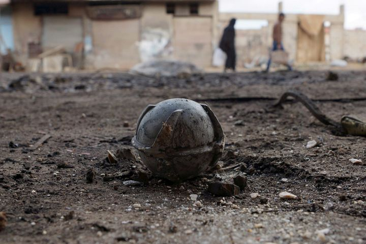 More than 100 countries have banned cluster munitions like this unexploded bomblet, pictured in Syria's Deraa province in Feb