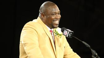 New inductee Warren Sapp talks during his acceptance into the NFL Pro Football Hall of Fame in Canton, Ohio August 3, 2013. REUTERS/Aaron Josefczyk (UNITED STATES - Tags: SPORT FOOTBALL)