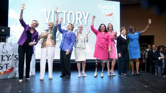 PHILADELPHIA, PA - JULY 27:  (L-R) Elizabeth Warren, Ellen Malcolm, Debbie Stabenow, Deborah Roos, Tammy Duckworth, Katie McGinty, Jeanne Shaheen and Val Demmings attend EMILY's List Breaking Through 2016 at the Democratic National Convention at Kimmel Center for the Performing Arts on July 27, 2016 in Philadelphia, Pennsylvania.  (Photo by Paul Zimmerman/Getty Images For EMILY's List)