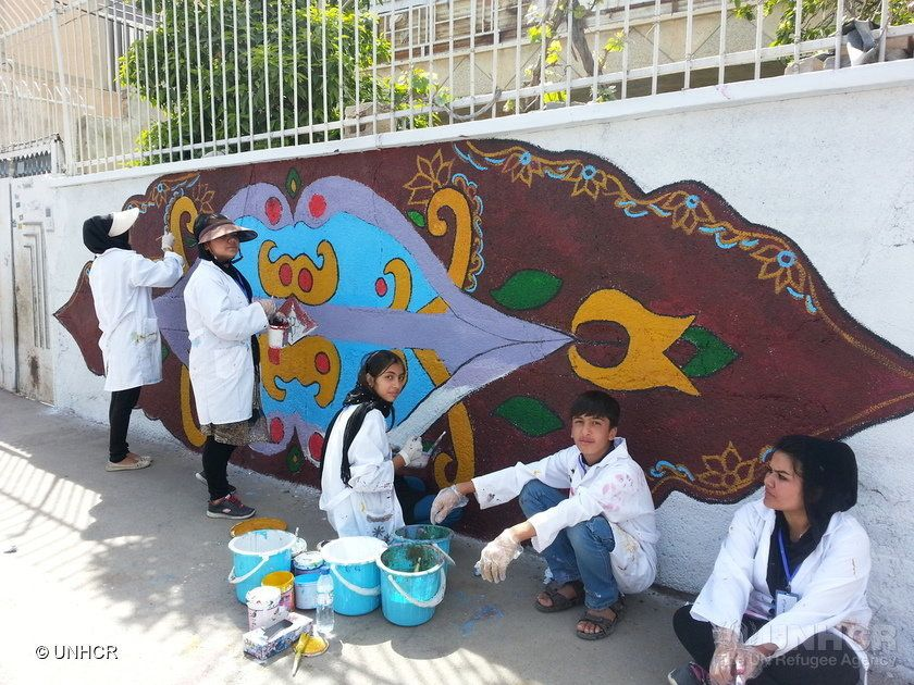 Volunteers paint as part of a week long community led mural painting project, Iranians together with Afghan refugees joined in painting beautiful wall murals over graffiti in their Saadi neighbourhood in Shiraz, Iran. ; Named after one of Iran�s most cherished poets, the Saadi neighbourhood in Shiraz is known throughout the country as �the city of poets�, and is home to a large population of Afghans. Iran has shown great generosity in hosting almost 1 million refugees during a protracted refugee situation for almost 40 years, UNHCR community-led projects are strengthening the social fabric of Afghans and Iranians living in Iran.
