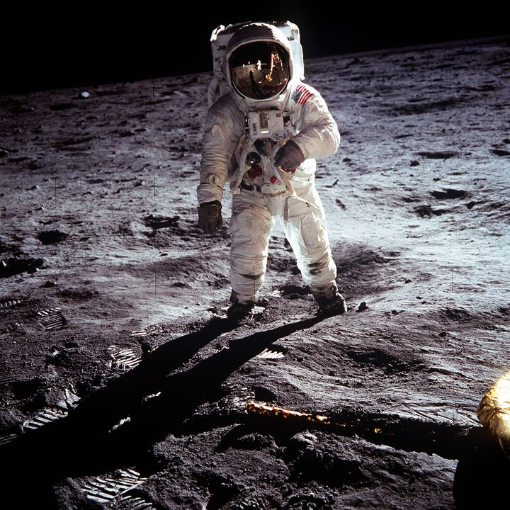 """This NASA file image shows Apollo 11 U.S. astronaut Buzz Aldrin standing on the Moon, next to the Lunar Module """"Eagle"""" (R), J"""
