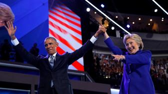 U.S. President Barack Obama and Democratic Nominee for President Hillary Clinton appear onstage together after Obama addressed the third night of the 2016 Democratic National Convention in Philadelphia, Pennsylvania, U.S., July 27, 2016.  REUTERS/Jim Young