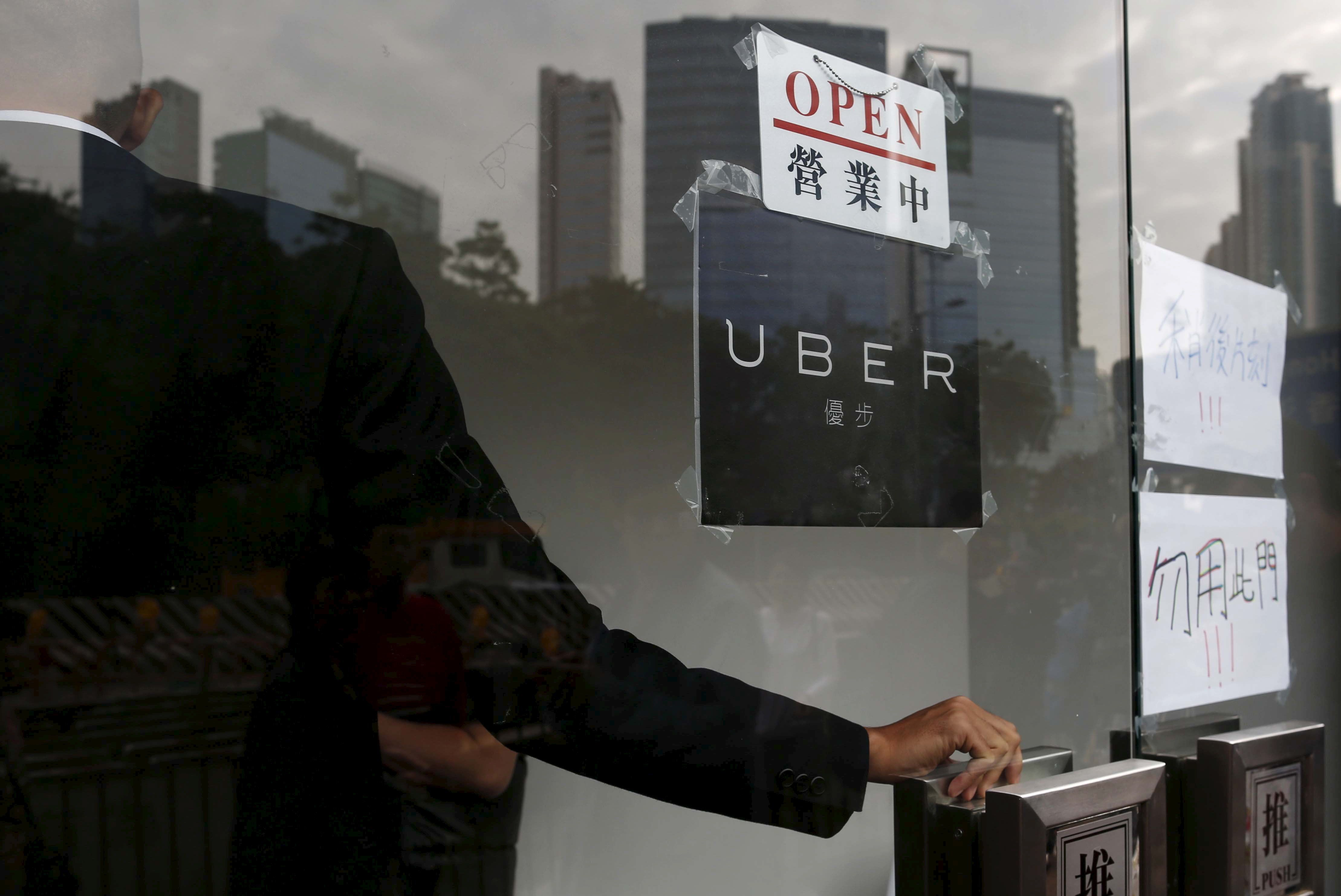 An open sign is seen at the office of Uber Inc during a driver recruitment event in Hong Kong, China December 29, 2015.