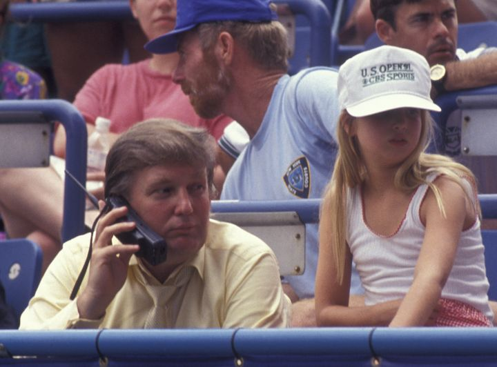 Trump takes a call while attending the 1991 U.S. Open Tennis Championship with daughter Ivanka.