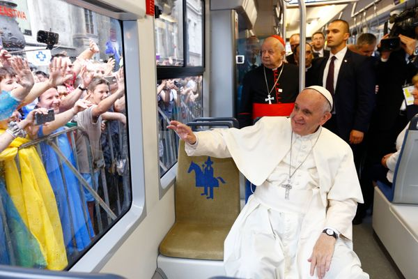 Pope Francis waves to faithful on his way to open the World Youth Day.