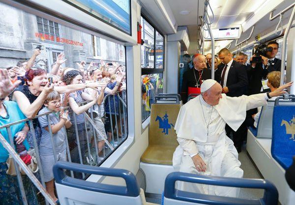 Pope Francis became the first pontiff to hop on an ordinary city tram Thursday as he travelled to the opening ceremony of an