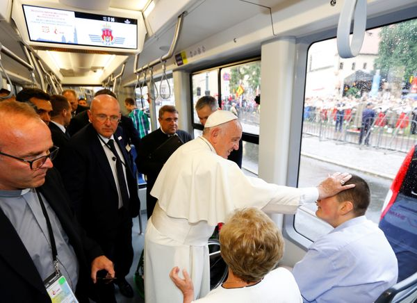 Pope Francis blesses a youth as he arrives by tram at the World Youth Day in Krakow, Poland July 28, 2016.