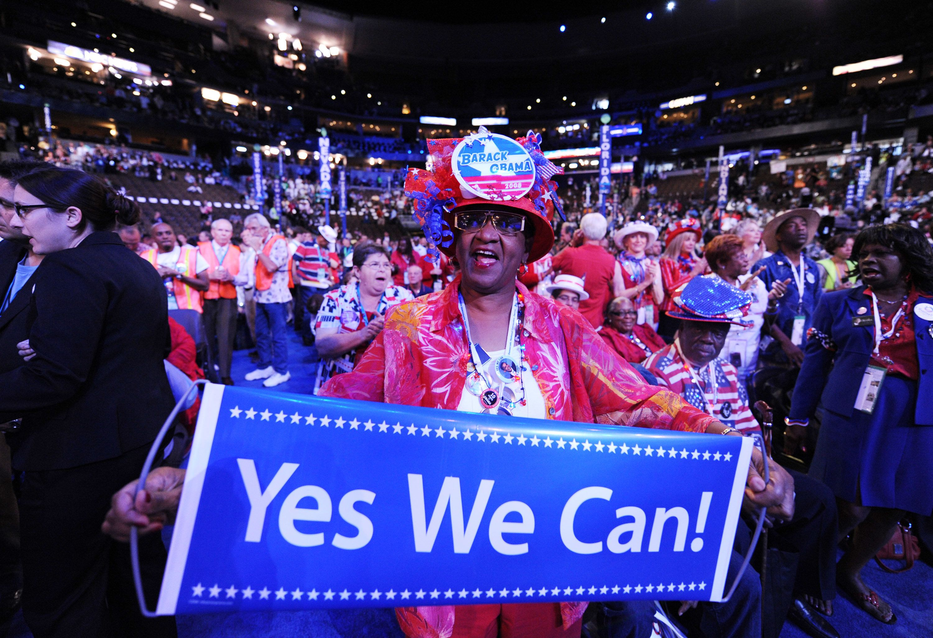 A delegate supporting Democratic presidential nominee Sen. Barack Obama holds a 'Yes We Can!' banner on the convention floor at the Democratic National Convention in Denver, Colorado, Wednesday, August 27, 2008.  (Photo by Olivier Douliery/Abaca Press/MCT via Getty Images)
