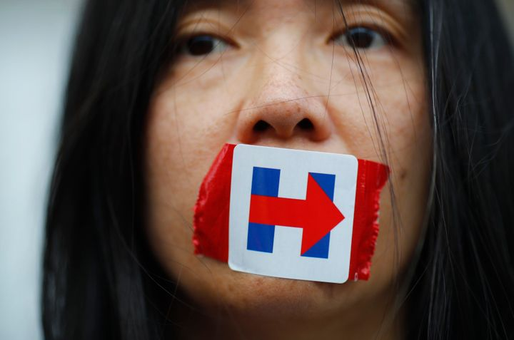 A former Bernie Sanders delegate wears a Clinton campaign sticker over her mouth in protest at the DNC, July 27, 2016.