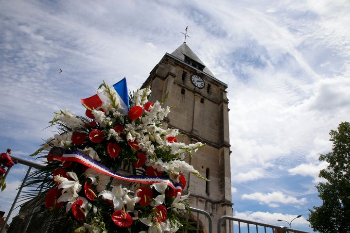 Flowers pay tribute to French priest Father Jacques Hamel outside the parish church at Saint-Etienne-du-Rouvray.