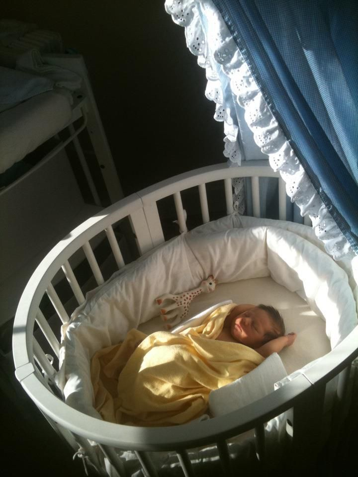 Maddox in his crib at one and a half months