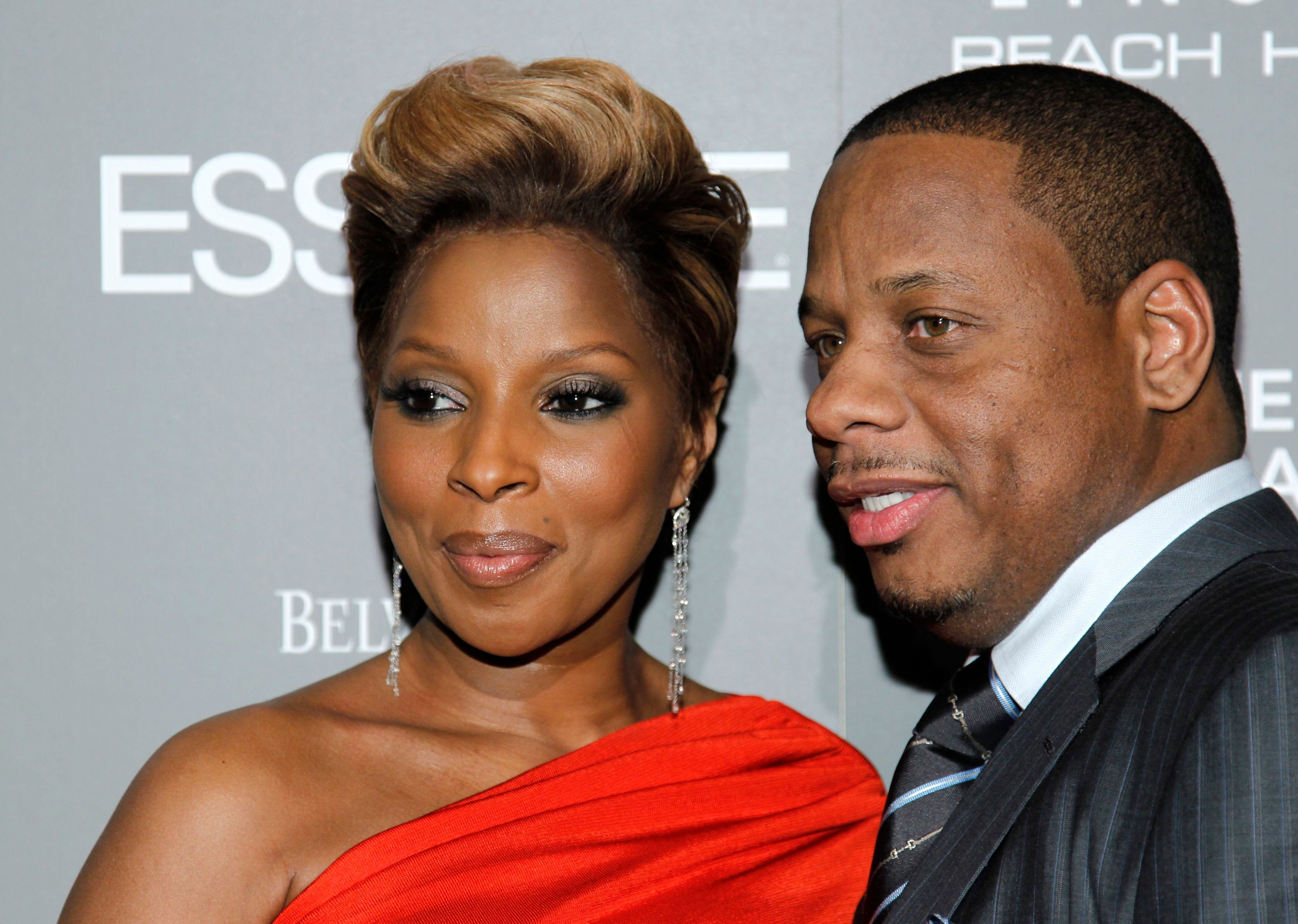 Honoree Mary J. Blige, left, and her husband Kendu Isaacs arrives at the Essence Black Women in Music: Honoring the Career & Accomplishments of Mary J. Blige reception in West Hollywood, Calif. on Wednesday, Jan. 27, 2009. (AP Photo/Danny Moloshok)
