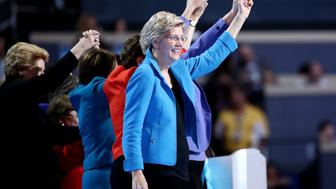 PHILADELPHIA, PA - JULY 28:  Sen. Elizabeth Warren (D-MA) along with members of the Democratic Women of the Senate acknowledge the crowd on the fourth day of the Democratic National Convention at the Wells Fargo Center, July 28, 2016 in Philadelphia, Pennsylvania. Democratic presidential candidate Hillary Clinton received the number of votes needed to secure the party's nomination. An estimated 50,000 people are expected in Philadelphia, including hundreds of protesters and members of the media. The four-day Democratic National Convention kicked off July 25.  (Photo by Jessica Kourkounis/Getty Images)