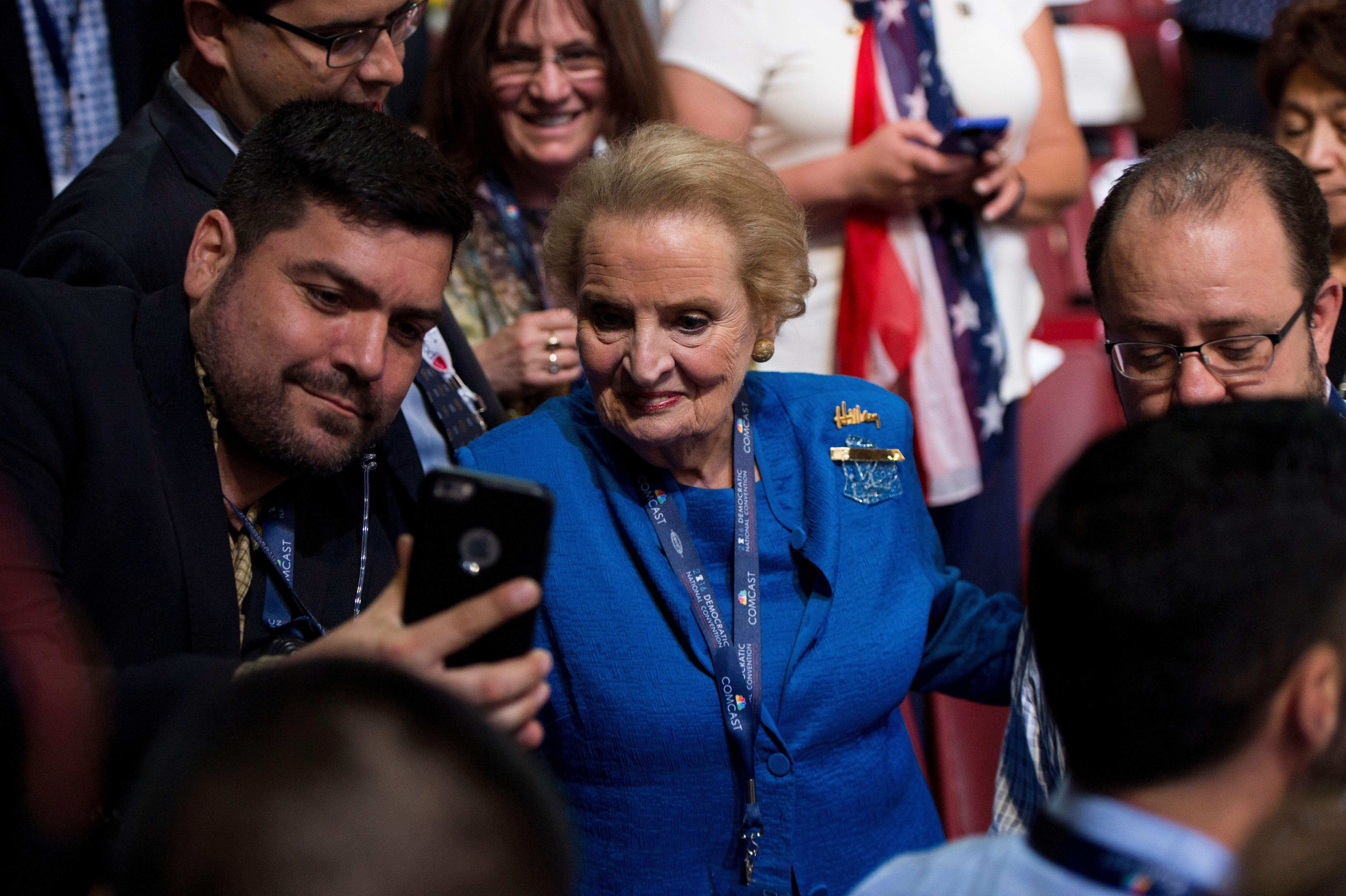 UNITED STATES - JULY 28: Former Secretary of State Madeleine Albright stops to pose for selfies with members of the Colorado delegation as she walks to the floor at the Democratic National Convention in Philadelphia on Thursday, July 28, 2016. Sarah became the first transgender person to address a national political convention. (Photo By Bill Clark/CQ Roll Call)