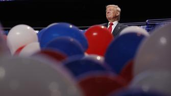 Republican U.S. presidential nominee Donald Trump stands amid dropped balloons at the conclusion of the final session of the Republican National Convention in Cleveland, Ohio, U.S. July 21, 2016. REUTERS/Jonathan Ernst