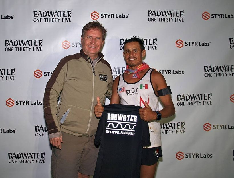 Race Director Chris Kostman with Oswaldo Lopez at finish line