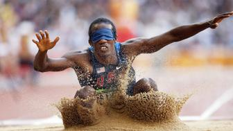 Lex Gillette of the US lands in the sand during the final of the men's long jump F11 classification event at the 2008 Beijing Paralympic Games in Beijing on September 15, 2008. Gillette finished in second place in the event.      AFP PHOTO (Photo credit should read AFP/AFP/Getty Images)