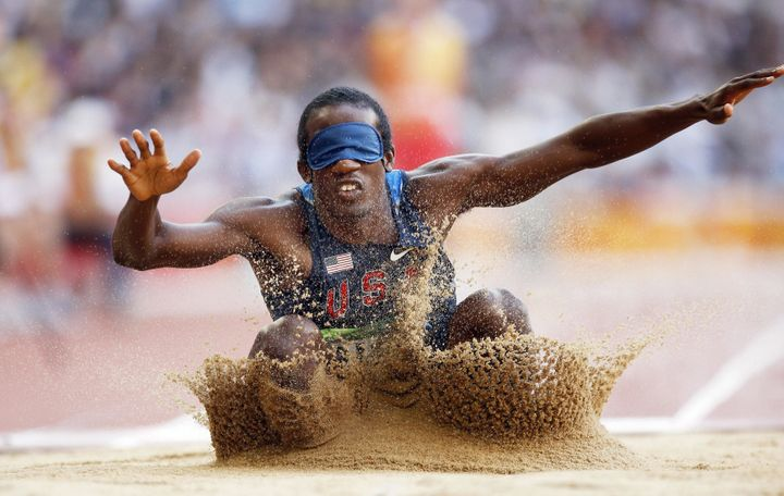 Lex Gillette of the US lands in the sand during the final of the men's long jump F11 classification event at the 2008 Beijing Paralympic Games in Beijing on September 15, 2008.