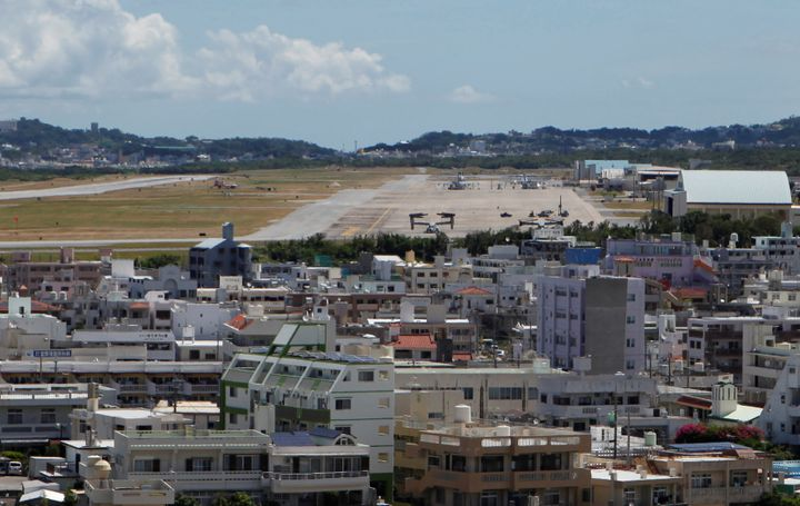 Osprey military aircraft are seen at the U.S. Futenma airbase in Ginowan, on the southern Japanese island of Okinawa, July 26
