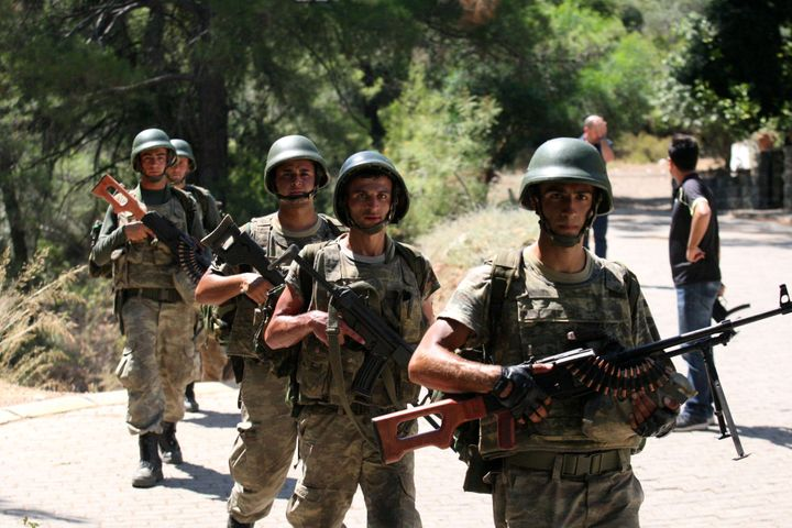 Turkish soldiers search for missing military personnel suspected of being involved in the coup attempt in Marmaris, Turkey, J