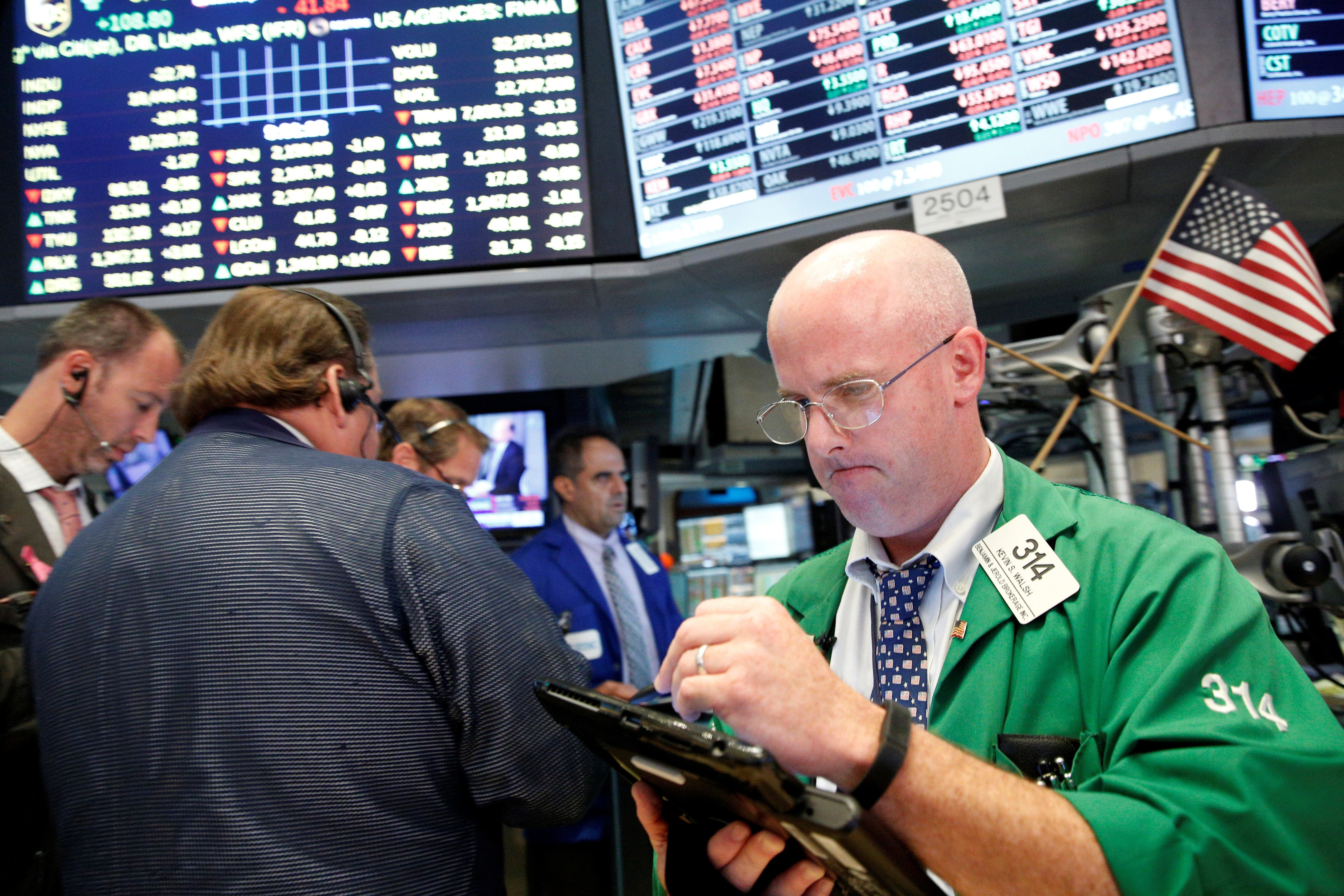 Traders work on the floor of the New York Stock Exchange (NYSE) in New York City, U.S., July 28, 2016.