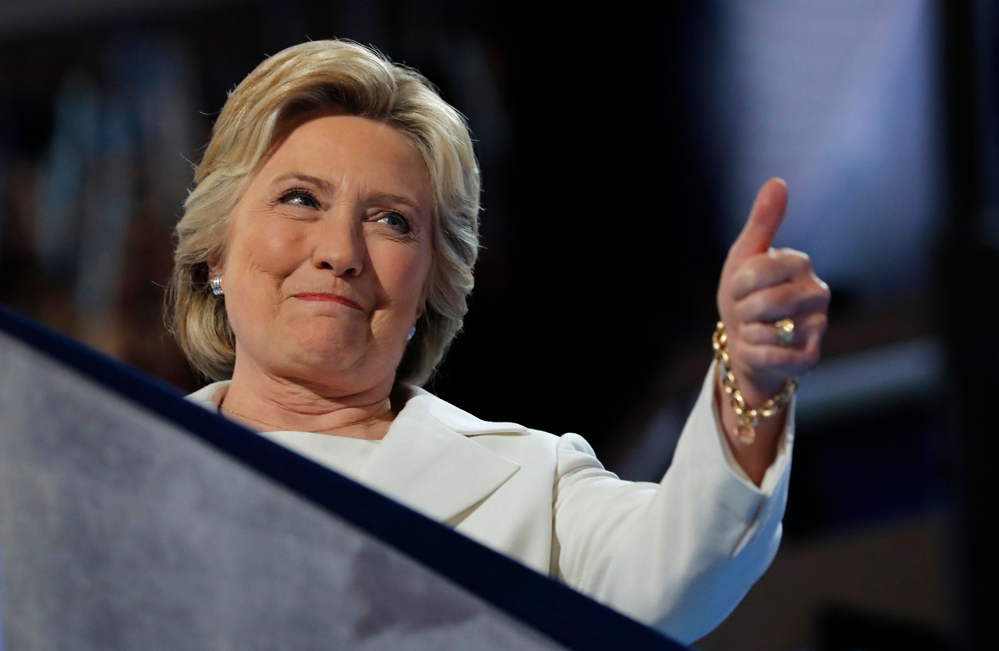 Democratic U.S. presidential nominee Hillary Clinton gives a thumbs up as she arrives to accept the nomination on the fourth and final night at the Democratic National Convention in Philadelphia, Pennsylvania, U.S. July 28, 2016. REUTERS/Jim Young