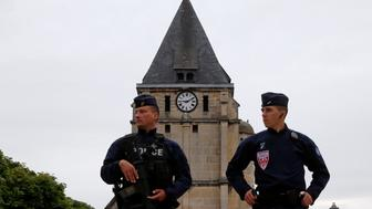 French CRS police stand guard in front of the church a day after a hostage-taking in Saint-Etienne-du-Rouvray near Rouen in Normandy, France, where French priest, Father Jacques Hamel, was killed with a knife and another hostage seriously wounded in an attack on the church that was carried out by assailants linked to Islamic State, July 27, 2016.    REUTERS/Pascal Rossignol
