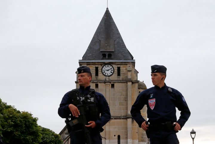 A Syrian refugee is in custody following the murder of an elderly priest at a church in Normandy.