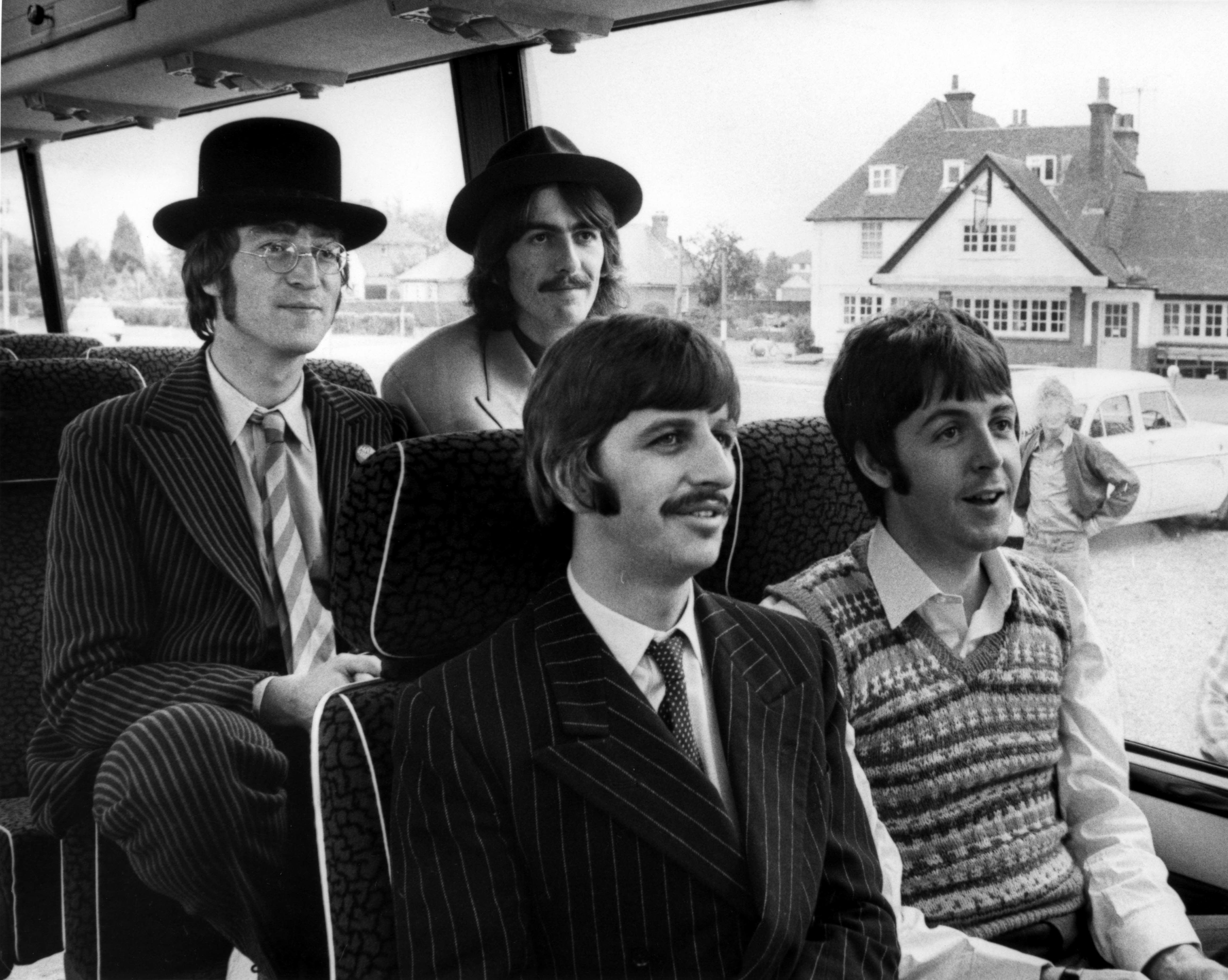 UNITED KINGDOM - SEPTEMBER 13:  Photo of BEATLES and MAGICAL MYSTERY TOUR; L-R. John Lennon, George Harrison, Ringo Starr, Paul McCartney - posed group shot, on bus, during filming of Magical Mystery Tour  (Photo by Cummings Archives/Redferns)
