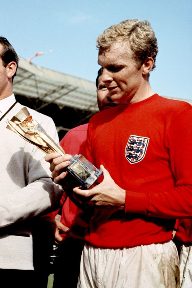 Bobby Moore has a close look at the Jules Rimet trophy after Englandwon the 1966 World