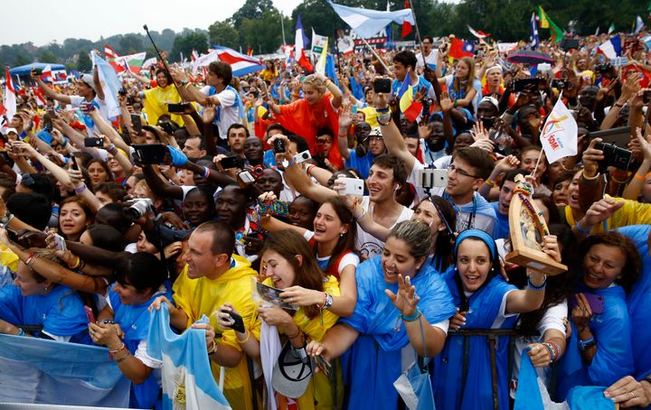 The faithful greet Pope Francis during World Youth Days in Krakow, Poland July 28, 2016.