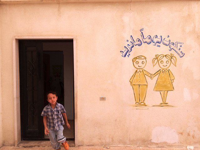 A Syrian child at an informal school for refugee kids in Lebanon's Bekaa Valley.